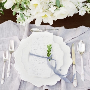 Elegant white and gray place setting on Aisle Perfect
