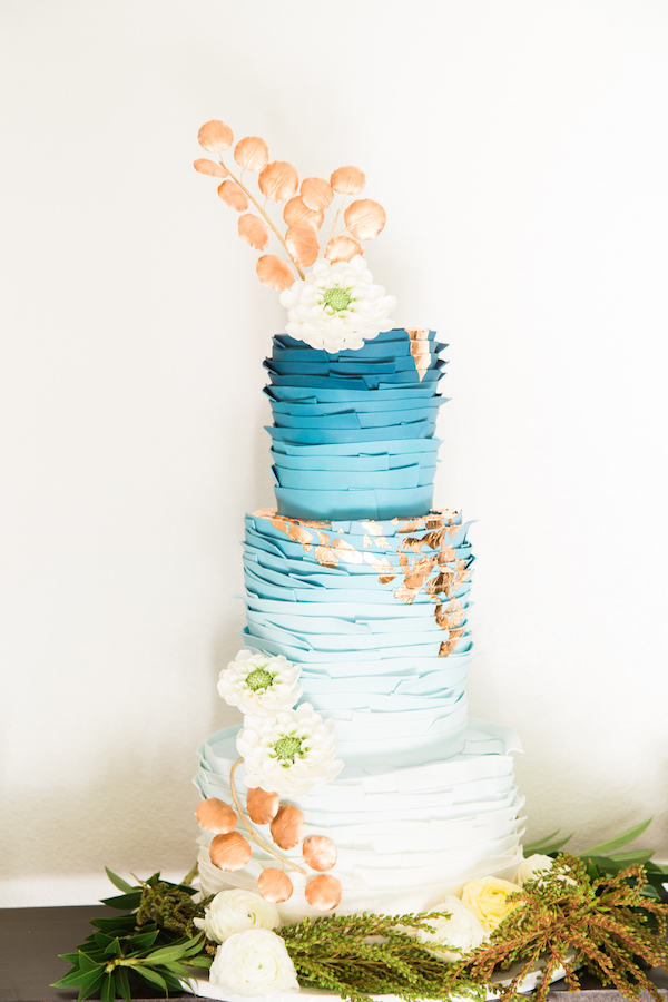 blue and copper wedding cake on Aisle Perfect