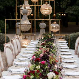 Long wedding table with lush floral runner