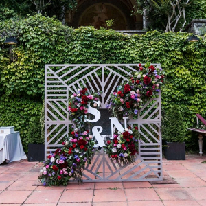 Statement floral and initial wedding backdrop