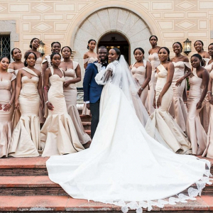 Bridal party in long taupe gowns with bride in long sleeve couture gown