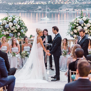 Glam waterside terrace wedding ceremony