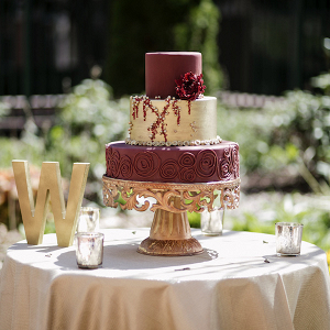 Burgundy and gold wedding cake