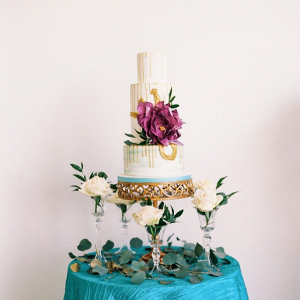 Drip wedding cake with oversized sugar flower