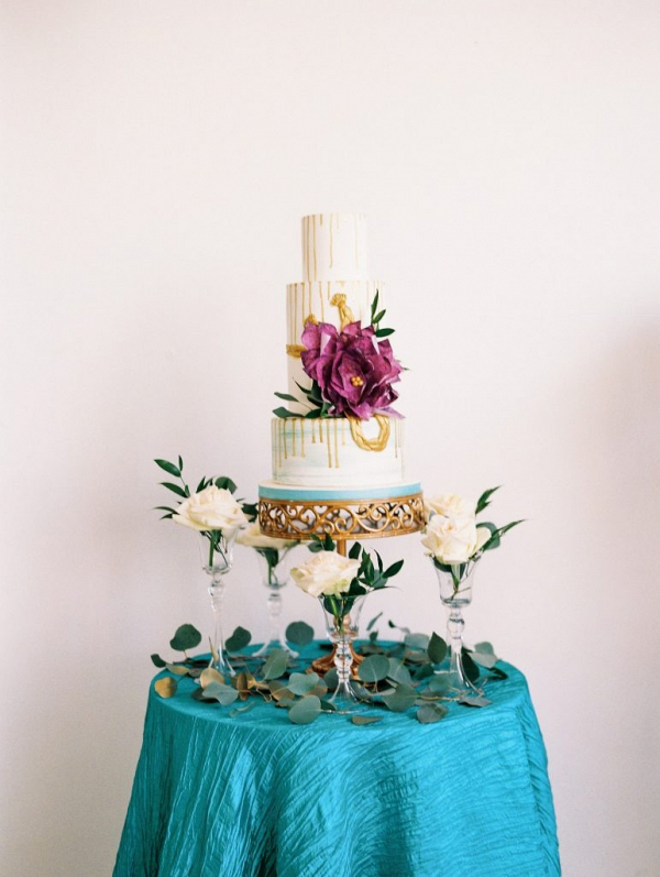 Drip wedding cake with oversized sugar flower