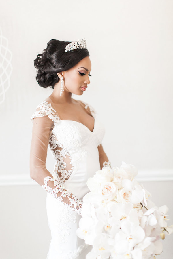 Bride in long sleeve gown on Aisle Perfect