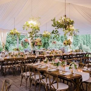 Greenery chandelier tented wedding reception