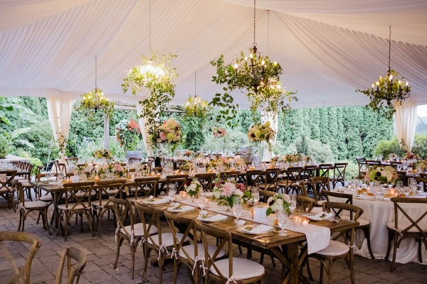 Greenery chandelier tented wedding reception