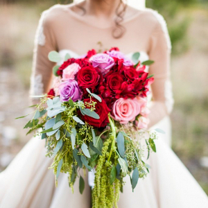 Bride holding trailing bouquet