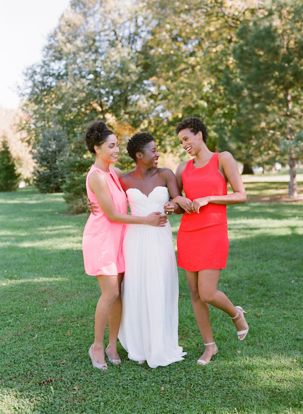 Bride with bridesmaids in bright dresses