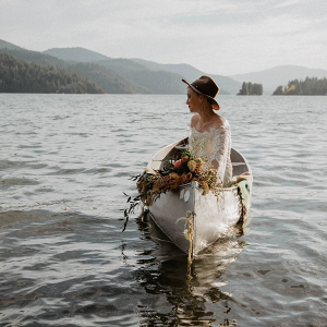 Boho bride in canoe
