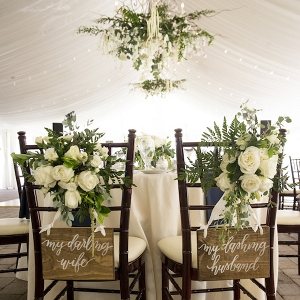 Cheeky Signs Flanked the Bride and Grooms Chairs and the Reception, Adding a Sweet Touch