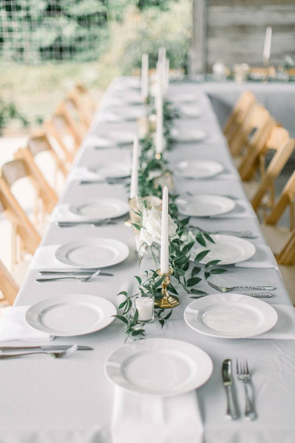 Minimalist taper candle and greenery centerpiece