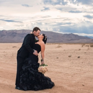 Newlywed portraits in the desert with all black attire for the bride and groom
