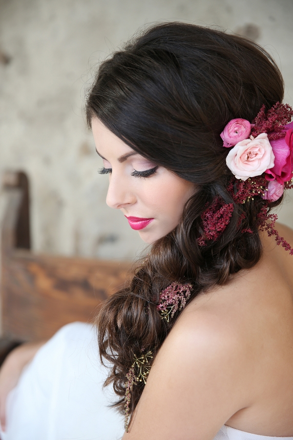 Bride With Flowers Braided Into Her Hair