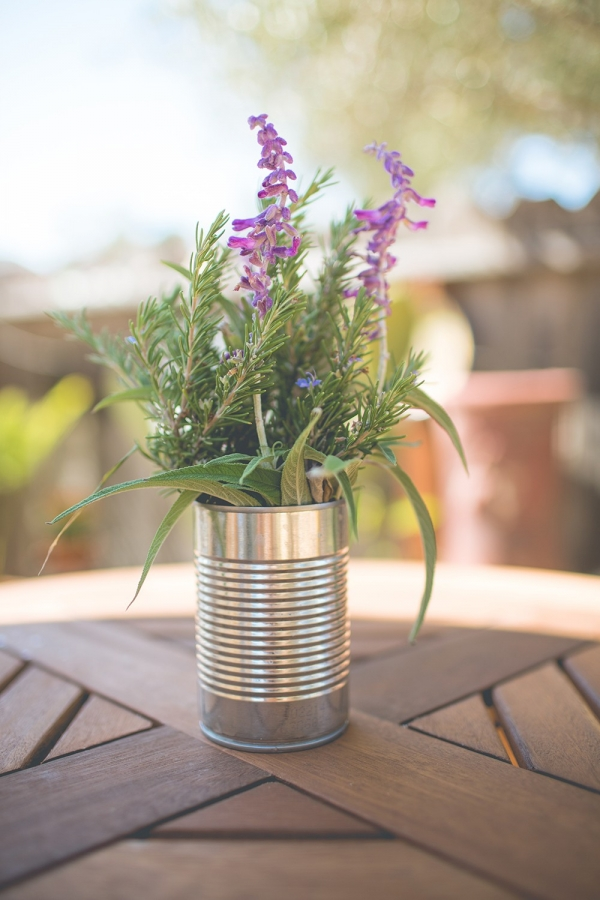 Handpicked floral and herb centerpieces in aluminum cans