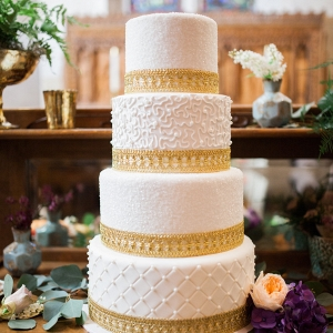 Four Tiered White and Gold Wedding Cake