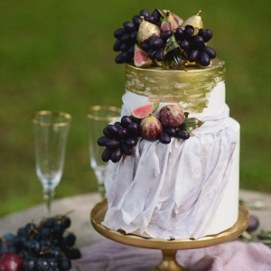 Wedding Cake with Golden Details and Fresh Figs and Grapes