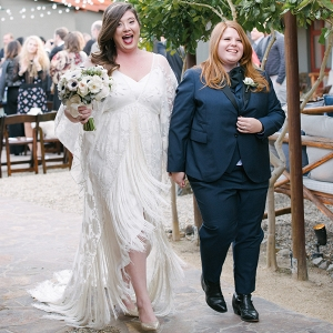 Newlywed Couple In Fringed White Dress And Indigo Suit