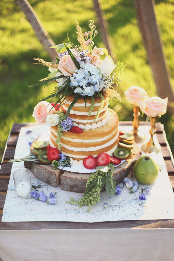 Naked Cake Decorated with Berries and Flowers
