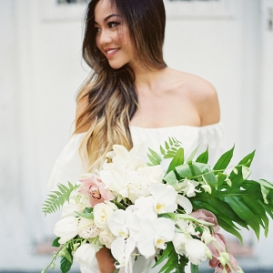 Bride with Large Tropical Bouquet