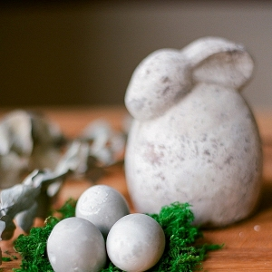 Three Cement Easter Eggs on Fake Grass and Rabbit