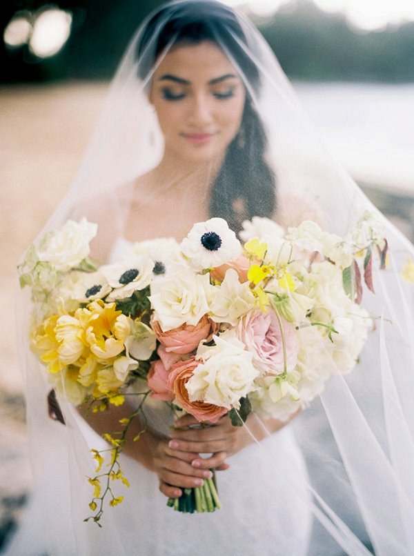 Veiled Bride with Yellow and Pink Bouquet