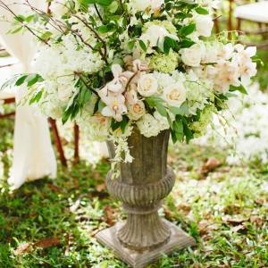 Ceremony Floral Arrangement In Garden Urn