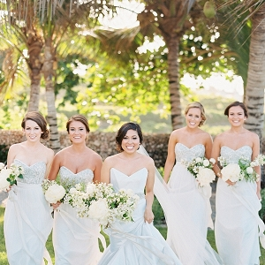 A Bride and Bridesmaids In Strapless Dresses