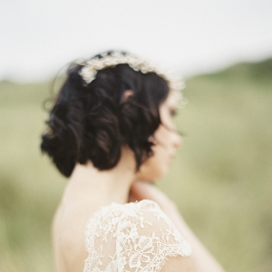 A Bride Wearing A Headpiece And Wedding Dres