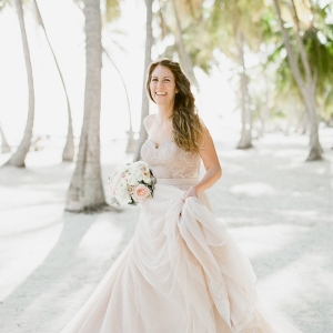 Bride in Blush Corset and Skirt Holding a Pastel Bouquet