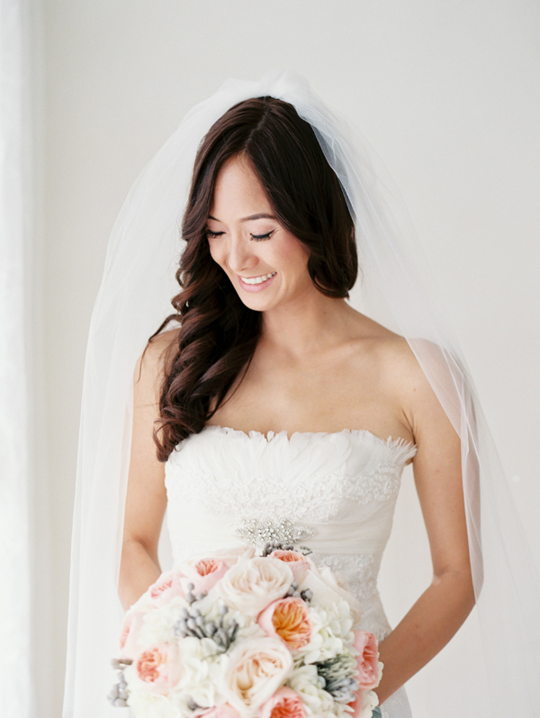 A Bride Holding A Peach and Blush Pink Bouquet