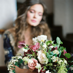 Bride Holding Purple and Pink Organic Bouquet