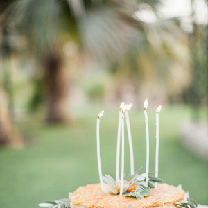 Wedding Cake with Greenery and Candles