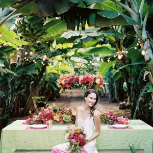 Bride with Bouquet Seated at a Colorful, Tropical Tablescape