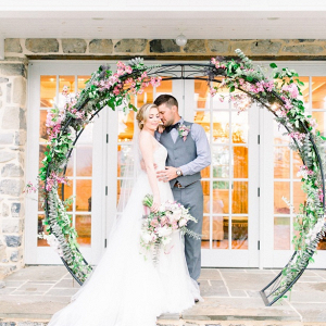Round floral ceremony backdrop