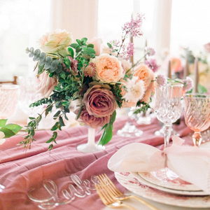 Peach and mauve wedding tablescape