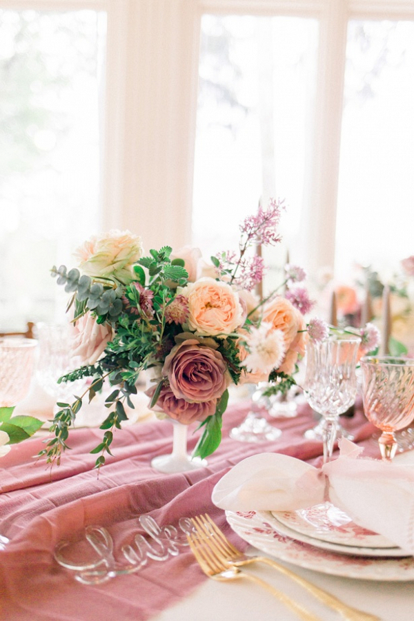 Peach and mauve wedding tablescape
