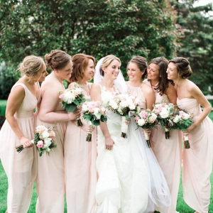 Bridesmaids in long blush gowns
