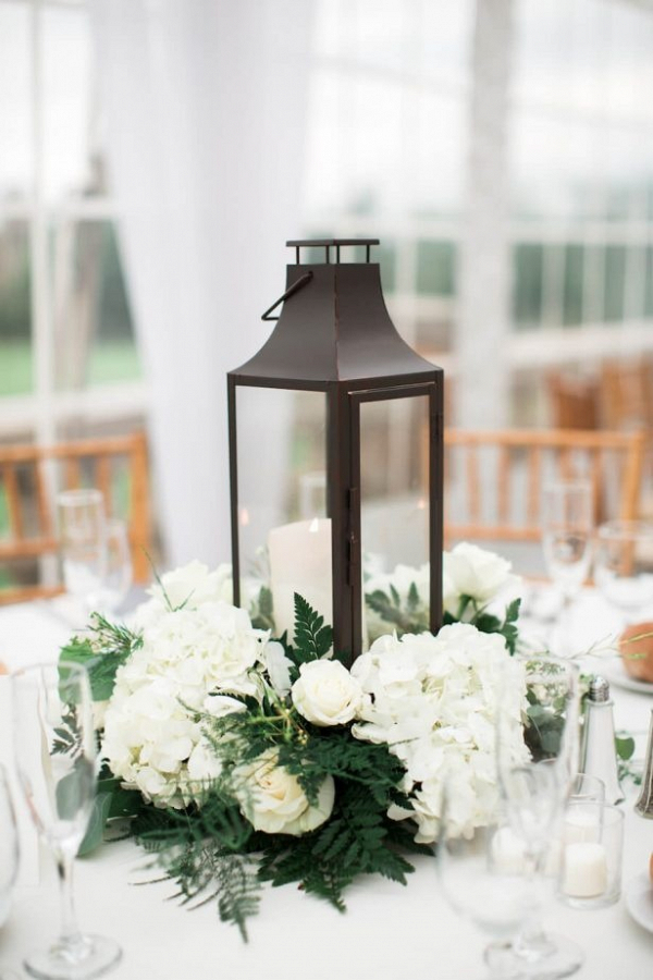 Classic lantern centerpiece with white floral wreath