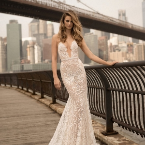 Plunge neckline wedding dress on Belle the Magazine