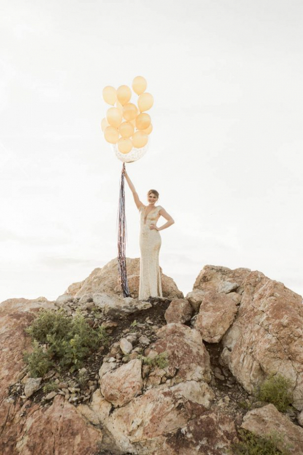 Bride in gold sequins with balloons