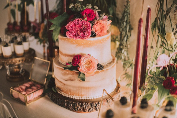 Semi naked cake with florals and blackberries on Belle the Magazine