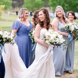 Bridesmaids in shades of blue dresses