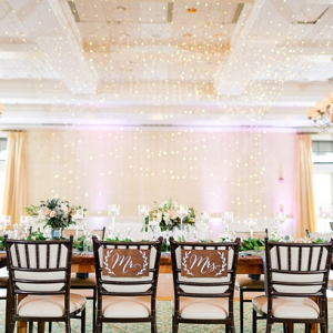 Elegant wedding reception with hanging string lights