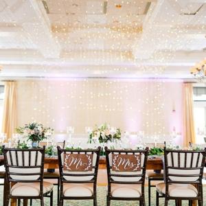 Elegant wedding reception with hanging string lights