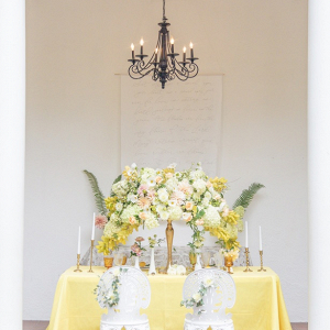 Yellow and peach wedding table with oversized floral centerpiece