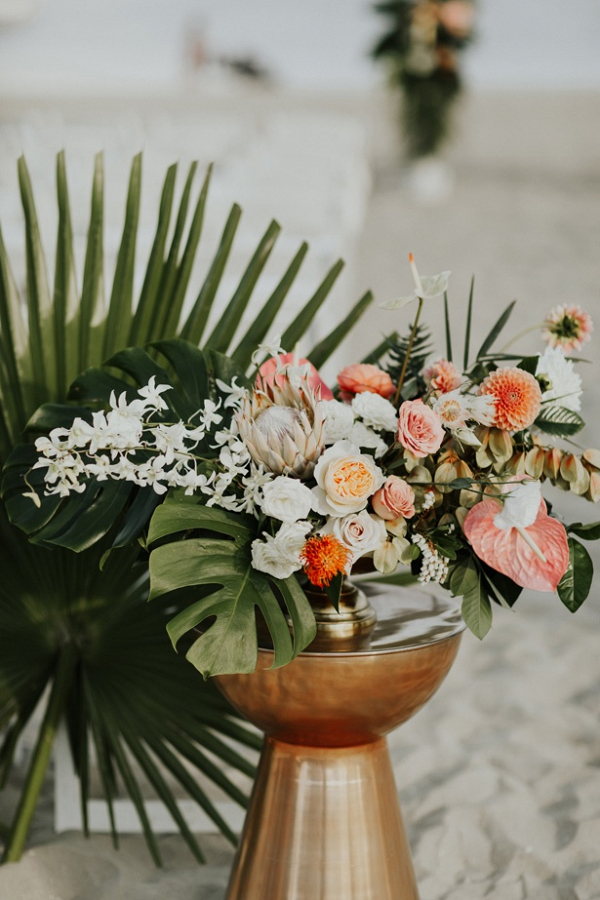 Tropical beach ceremony florals