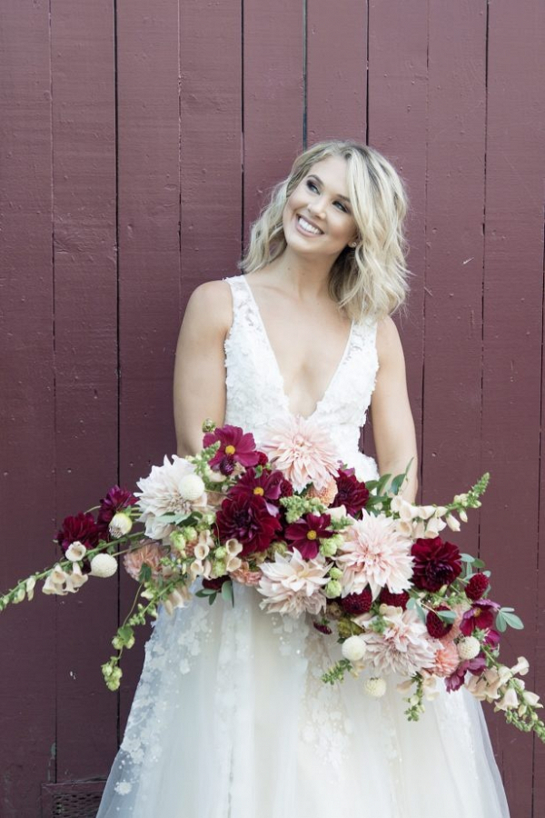 Lush bridal bouquet of red and pink dahlias
