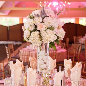 tall white and pink centerpiece on Belle the Magazine